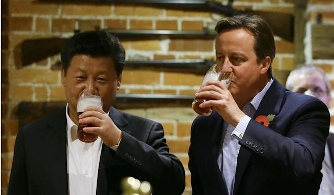 Xi Jinping went to a pub with David Cameron during his 2015 trip to Britain. Photo: AFP