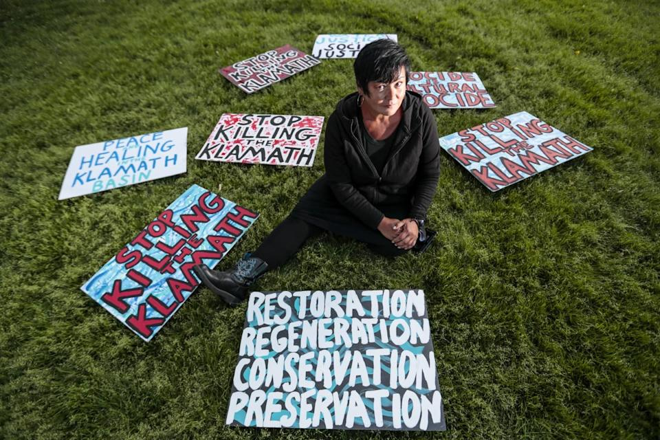 Klamath tribal member and activist Joey Gentry with protest signs
