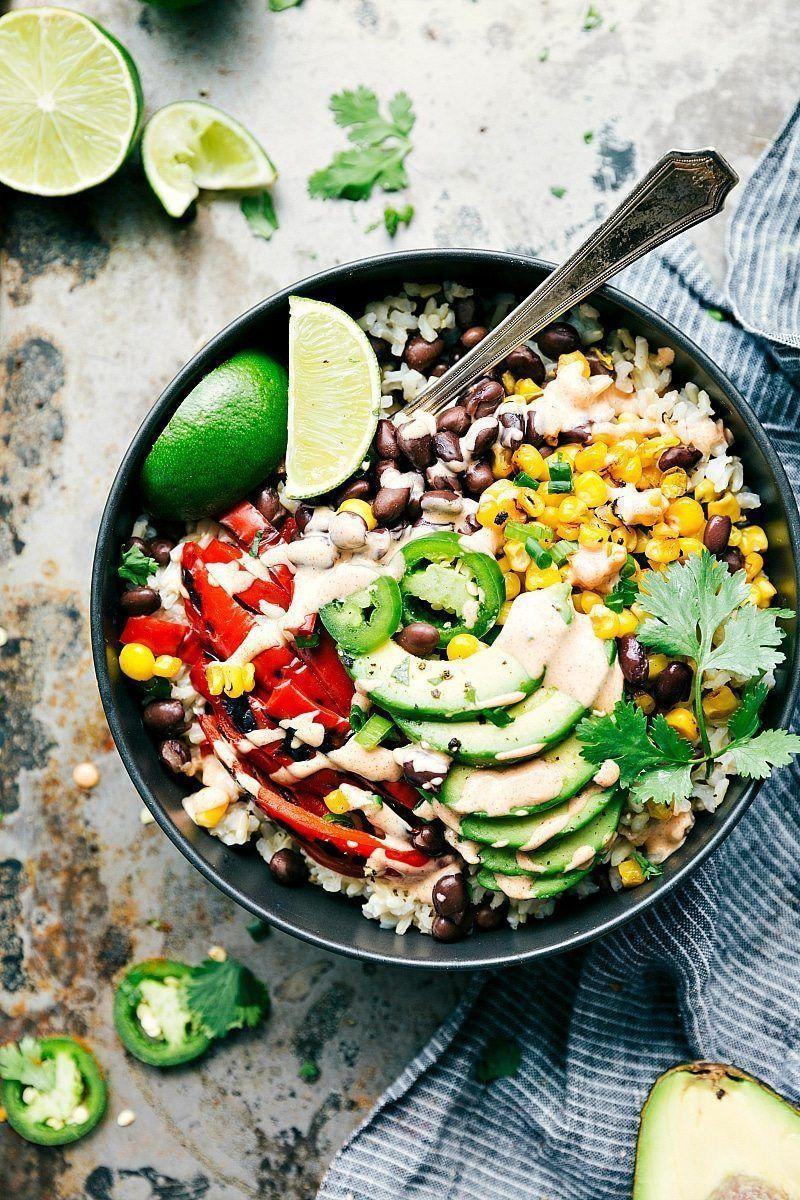 """<p>This burrito bowl recipe is full of fresh ingredients and a delicious avocado oil dressing.</p><p><strong>Get the recipe at <a href=""""https://www.chelseasmessyapron.com/healthy-mexican-street-corn-burrito-bowls/"""" rel=""""nofollow noopener"""" target=""""_blank"""" data-ylk=""""slk:Chelsea's Messy Apron"""" class=""""link rapid-noclick-resp"""">Chelsea's Messy Apron</a>.</strong></p>"""