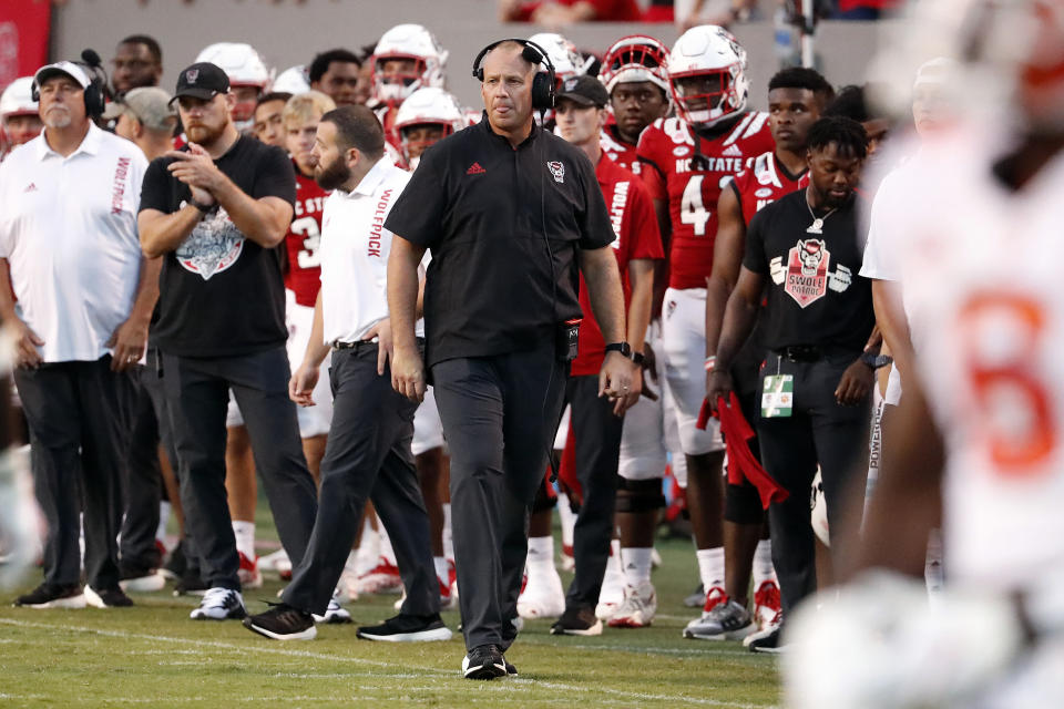 North Carolina State head coach Dave Doeren walks the sidelines during the second half of an NCAA college football game against Clemson in Raleigh, N.C., Saturday, Sept. 25, 2021. (AP Photo/Karl B DeBlaker)