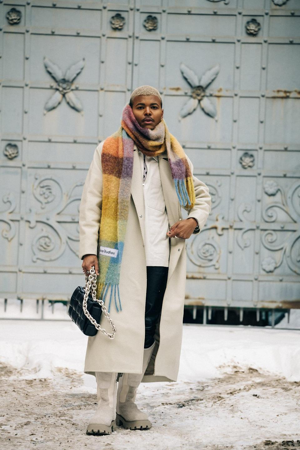 """<p>Allow your scarf to be the center of attention when you wrap it multiple times around your neck and """"bundle up."""" The look is cozy, but statement making, especially when your Acne Studio scarf comes in rainbow check.</p>"""