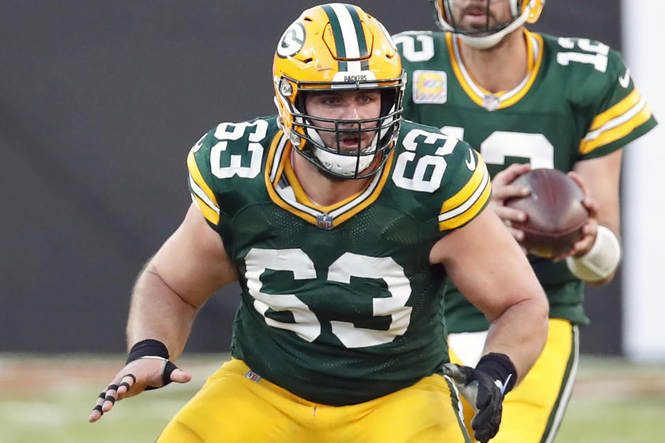 FILE - Green Bay Packers center Corey Linsley (63) blocks for quarterback Aaron Rodgers during an NFL football game against the Tampa Bay Buccaneers in Tampa, Fla., in this Sunday, Oct. 18, 2020, file photo. Linsley was selected Friday, Jan. 8, 2021, to The Associated Press All-Pro Team. (AP Photo/Jeff Haynes, File)