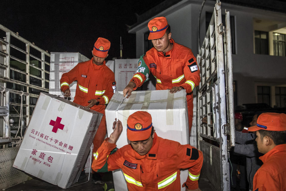 In this photo released by China's Xinhua News Agency, rescue personnel carry supplies after an earthquake in Yangbi Yi Autonomous County in southwestern China's Yunnan Province, early Saturday, May 22, 2021. A pair of strong earthquakes struck two provinces in China overnight on Saturday. (Hu Chao/Xinhua via AP)