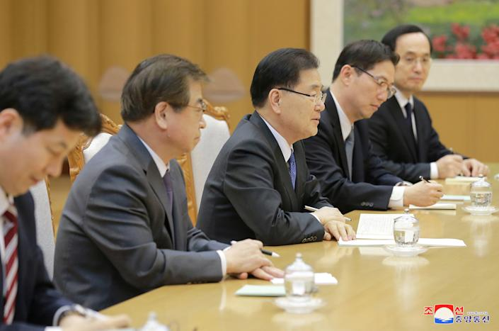 North Korean leader Kim Jong Un (not in picture) meets members of the special delegation.