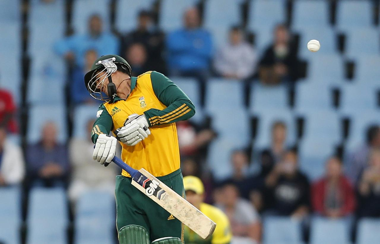 South Africa's Quinton de Kock reacts after he was hit by a ball during the final of the T20 cricket test match against Australia in Centurion, March 14, 2014. REUTERS/Siphiwe Sibeko (SOUTH AFRICA - Tags: SPORT CRICKET TPX IMAGES OF THE DAY)