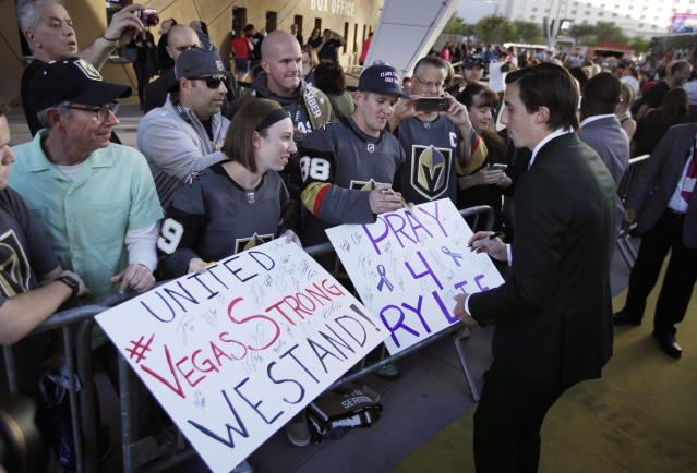 <p>Golden Knights players, including Marc-Andre Fleury (seen here), greet fans outside T-Mobile Arena ahead of their first home game. (John Locher/AP) </p>