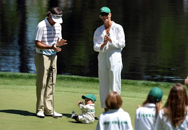 Bubba Watson of the US with his wife Angie Watson and son Caleb Watson during the Par 3 Contest held the day before the start of the 77th Masters golf tournament at Augusta National Golf Club on April 10, 2013 in Augusta, Georgia. AFP PHOTO / JEWEL SAMADJEWEL SAMAD/AFP/Getty Images