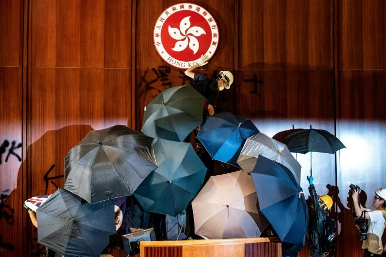 Protesters deface Hong Kong's emblem in parliament after unprecedented scenes in the territory on the anniversary of the handover to China