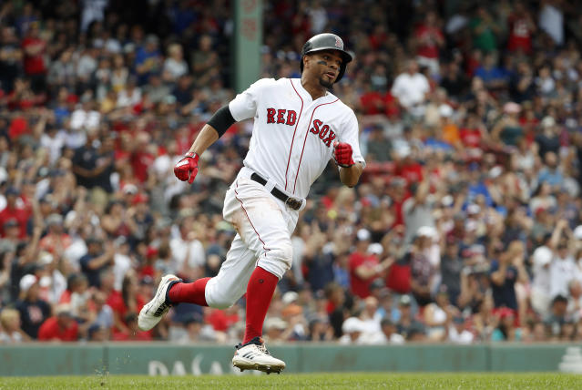 Boston Red Sox's Xander Bogaerts runs the bases after a double against the Toronto Blue Jays during the ninth inning of a baseball game Saturday, July 14, 2018, in Boston. (AP Photo/Winslow Townson)
