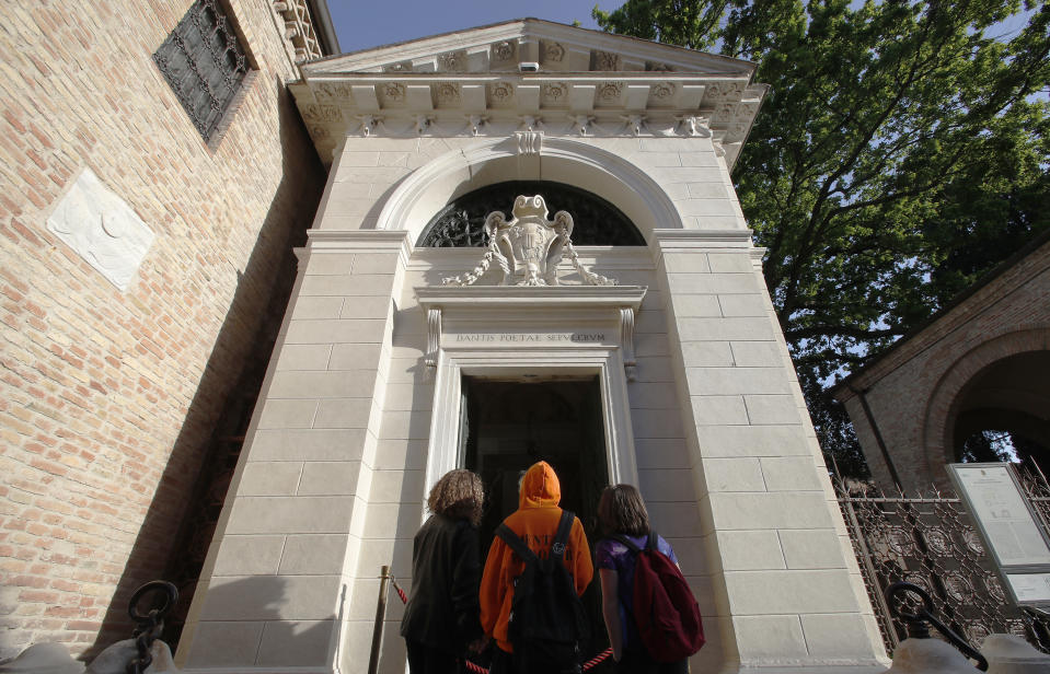 School children stand in front of poet Dante Alighieri's tomb, in Ravenna, Italy, Saturday, May 8, 2021. Italy is honoring its great poet in myriad ways on the 700th anniversary of his death, with new musical scores and gala concerts, exhibits and dramatic readings against stunning backgrounds in every corner of the land. (AP Photo/Antonio Calanni)