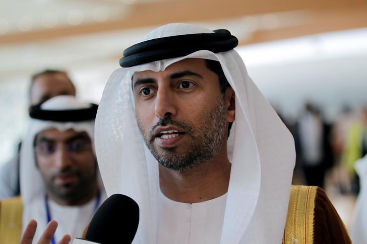 UAE Energy Minister Suhail bin Mohammed al-Mazroui talks to reporters during the 15th International Energy Forum Ministerial (IEF15) in Algiers