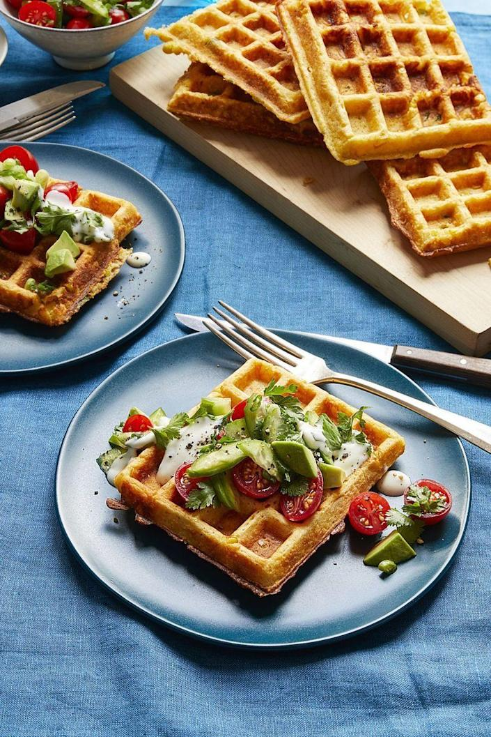 "<p>The sweetness from the waffles, the savory from the herb sald — it's all just too good. </p><p><strong><em><a href=""https://www.womansday.com/food-recipes/food-drinks/a16759286/savory-corn-waffles-with-tomato-herb-salad-recipe/"" rel=""nofollow noopener"" target=""_blank"" data-ylk=""slk:Get the Savory Corn Waffles with Tomato Herb Salad recipe."" class=""link rapid-noclick-resp"">Get the Savory Corn Waffles with Tomato Herb Salad recipe. </a> </em></strong></p>"