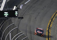 Christopher Bell gets the checkered flag as he drives to the finish line during the NASCAR Cup Series road-course auto race at Daytona International Speedway, Sunday, Feb. 21, 2021, in Daytona Beach, Fla. (AP Photo/Terry Renna)