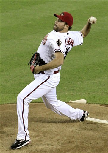 Arizona Diamondbacks' Josh Collmenter, gets a surprise start against the Chicago Cubs during the first inning in a baseball game on Friday, June 22, 2012, in Phoenix. Diamondbacks scheduled starter Joe Saunders was scratched. (AP Photo/Ross D. Franklin)