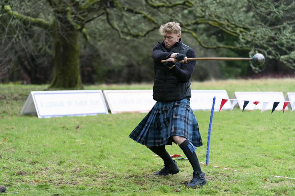 The A League Of their Own Road Trip stars compete in a Highland games in Scotland. (Sky)