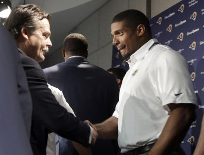 Coach Jeff Fisher and the Rams drafted Michael Sam in the seventh round of May's draft. (AP)