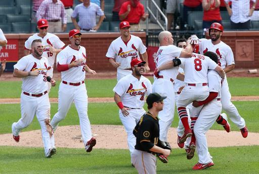 St. Louis Cardinals' Peter Bourjos (8) celebrates with teammates after driving in the game-winning run with a single in the ninth inning during a basseball game between the St. Louis Cardinals and the Pittsburgh Pirates on Wednesday, Sept. 3, 2014, at Busch Stadium in St. Louis. (AP Photo/St. Louis Post-Dispatch, Chris Lee)