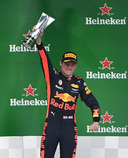 Red Bull's Dutch driver Max Verstappen celebrates on the podium after finishing third in the Formula One Chinese Grand Prix, in Shanghai, on April 9, 2017