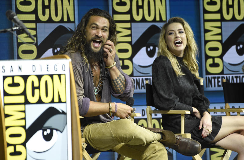 "Jason Momoa, left, and Amber Heard attend the Warner Bros. Theatrical panel for ""Aquaman"" on day three of Comic-Con International on Saturday, July 21, 2018, in San Diego. (Photo by Chris Pizzello/Invision/AP)"