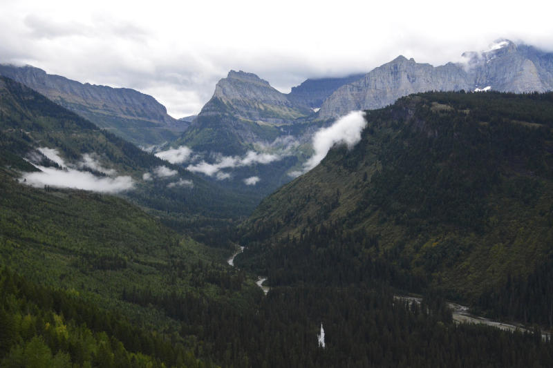 FILE - This Sept. 6, 2016 file photo shows the view from Going-to-the-Sun Road in Glacier National Park, Mont. Glacier National Park officials are teed off over a report that tourists were hitting golf balls off Going-to-the-Sun Road during a traffic delay. On Friday, July 19, 2019, Glacier spokeswoman Lauren Alley told the Missoulian the incident is under investigation. (Lewis Kendall/Bozeman Daily Chronicle via AP, File)
