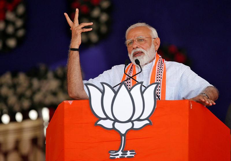 India's Prime Minister Narendra Modi addresses an election campaign rally in Junagadh