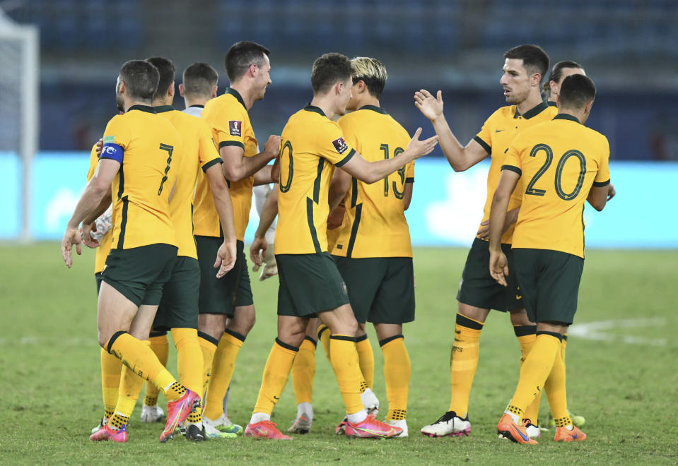 Australia's Ajdin Hrustic, center, celebrates with his teammates after scoring his side's third goal during the World Cup 2022 Group B qualifying soccer match between Kuwait and Australia in Kuwait City, Kuwait, Thursday, June 3, 2021. (AP Photo/Jaber Abdulkhaleg)