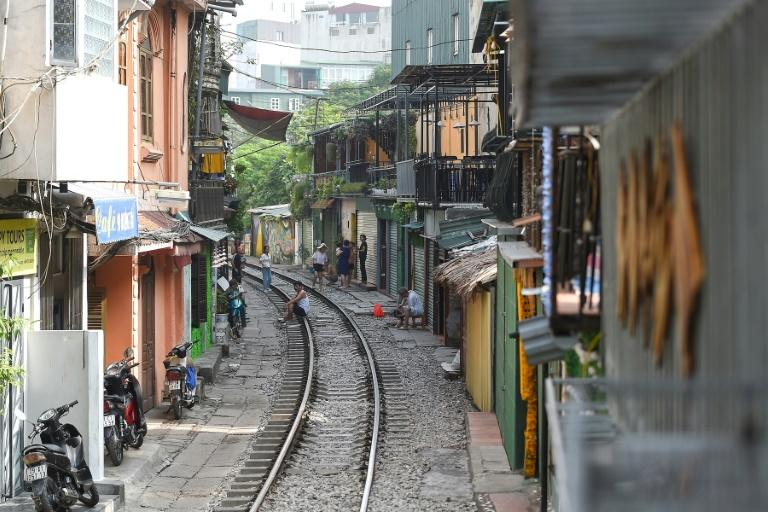 The stretch of the tracks was once known as a rough part of town, occupied by drug users and squatters until their recent discovery by camera-wielding holidaymakers (AFP Photo/Nhac NGUYEN)