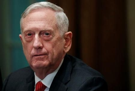 FILE PHOTO: U.S. Defense Secretary James Mattis listens as U.S. President Donald Trump speaks to the news media while gathering for a briefing from his senior military leaders in the Cabinet Room at the White House in Washington