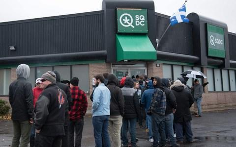 <span>People line up outside of a cannabis store in Quebec City, Quebec</span> <span>Credit: ALICE CHICHE/AFP/Getty Images </span>