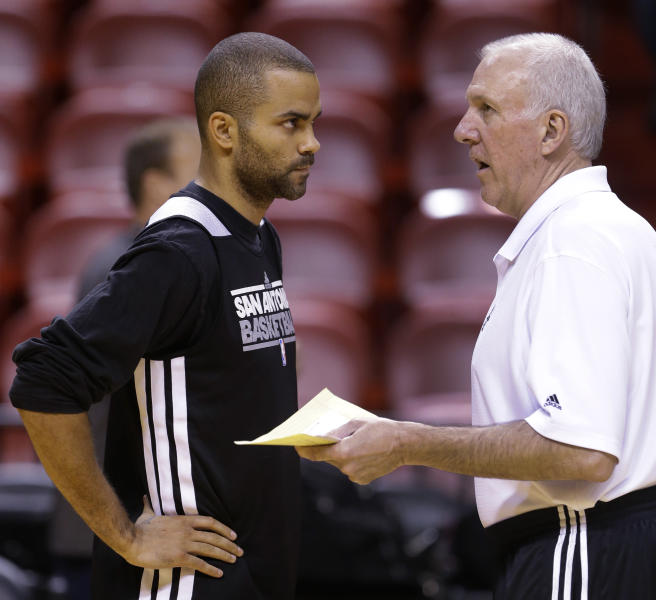 San Antonio Spurs point guard Tony Parker, left, of France, talks with head coach Gregg Popovich during basketball practice, Saturday, June 8, 2013, at the American Airlines Arena in Miami. The Miami Heat and the Spurs are to play Game 2 of the NBA Finals, Sunday. (AP Photo/Wilfredo Lee)