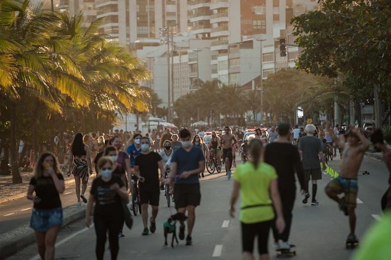 People are seen practicing exercises on an avenue reserved for leisure, on the edge of the ipanema beach located in the south of the city of Rio de Janeiro, Brazil, on July 19, 2020. Local authorities have started the 4th (fourth) of the 6 stages of easing social isolation (quarantine), which allows for some team sports on the beach except for weekends. Rio de Janeiro surpassed the 11,000 deaths caused by the Coronavirus (COVID-19) and more than 135,000 confirmed cases of the disease. (Photo by Allan Carvalho/NurPhoto via Getty Images)