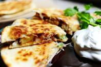 """<p>How genius is this? Put pineapple in a quesadilla, and you'll be wowed by the sweet-and-savory taste that ensues.</p><p><strong><a href=""""https://thepioneerwoman.com/cooking/grilled-chicken-pineapple-quesadillas/"""" rel=""""nofollow noopener"""" target=""""_blank"""" data-ylk=""""slk:Get the recipe."""" class=""""link rapid-noclick-resp"""">Get the recipe.</a></strong></p><p><a class=""""link rapid-noclick-resp"""" href=""""https://go.redirectingat.com?id=74968X1596630&url=https%3A%2F%2Fwww.walmart.com%2Fip%2FThe-Pioneer-Woman-Timeless-Beauty-Pre-Seasoned-Plus-20-Cast-Iron-Double-Griddle%2F117723541&sref=https%3A%2F%2Fwww.thepioneerwoman.com%2Ffood-cooking%2Fmeals-menus%2Fg32188535%2Fbest-grilling-recipes%2F"""" rel=""""nofollow noopener"""" target=""""_blank"""" data-ylk=""""slk:SHOP GRIDDLES"""">SHOP GRIDDLES </a></p>"""