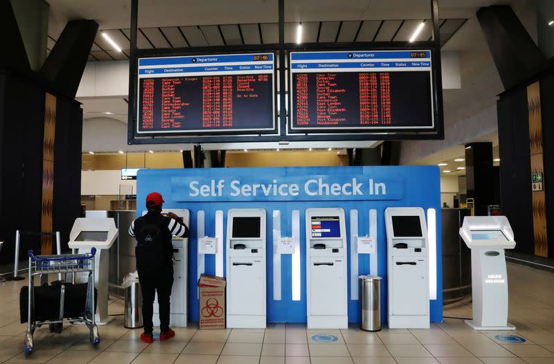 A passenger is seen at the self service check-in counter at the O.R. Tambo International Airport in Johannesburg