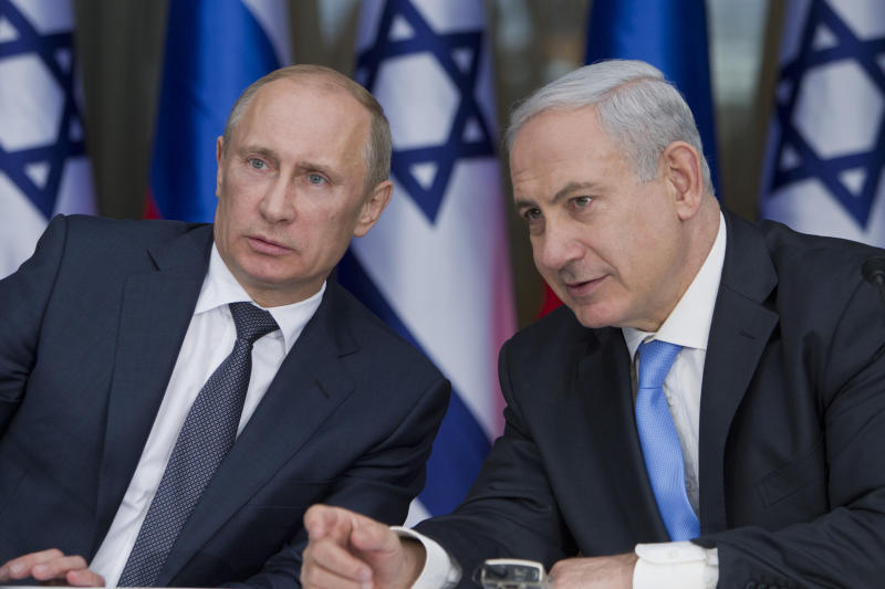 "Russian President Vladimir Putin, left, and Israeli Prime Minister Benjamin Netanyahu prepare to deliver joint statements after their meeting in the Israeli leader's Jerusalem residence, Monday, June 25, 2012. Netanyahu says Russian President Vladimir Putin agrees that a nuclear Iran would pose a ""grave danger"" to the world. Netanyahu pressed for further sanctions on the Islamic Republic to quash its budding nuclear program. In statements after their meeting Monday, Putin acknowledged that the talks covered Iran and the uprising in Syria, but added that he saw negotiations as the only solution for such matters. (AP Photo/Jim Hollander, Pool)"