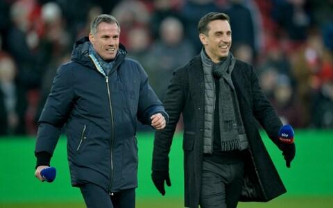 Former Liverpool player Jamie Carragher and former Manchester United player Gary Neville at Anfield - Credit: REX