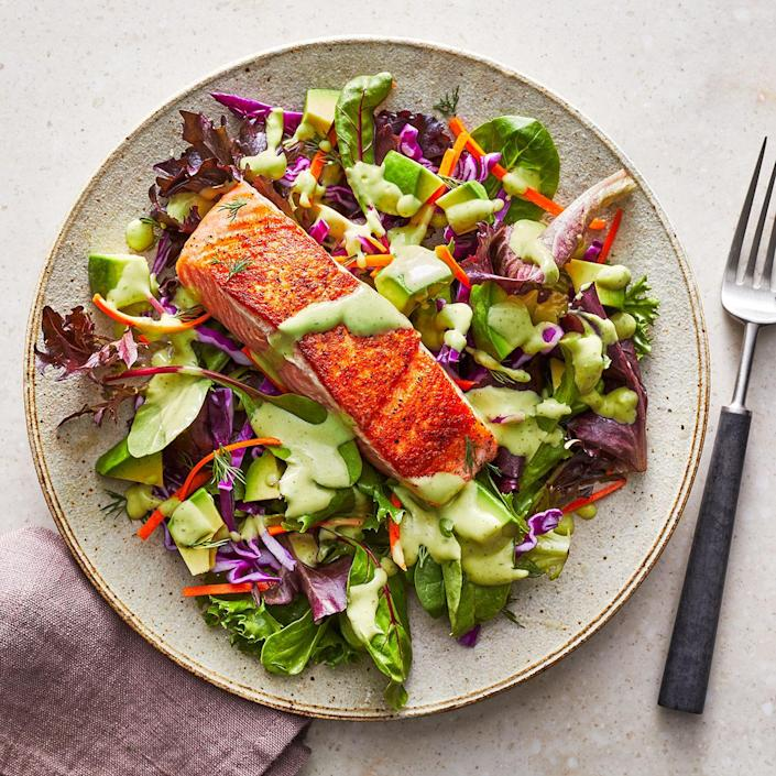 <p>Tender salmon tops a hearty salad of red cabbage, carrots and avocados tossed with a creamy dill vinaigrette in this quick, easy dinner.</p>