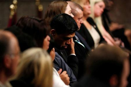 Victor Sibayan (C), whose son U.S. Navy sailor Carlos Sibayan was killed in a collision aboard the USS Fitzgerald in June, wipes away tears during a Senate Armed Services Committee hearing on recent fatal United States Navy ship collisions at sea, on Capitol Hill in Washington, U.S. September 19, 2017. REUTERS/Jonathan Ernst
