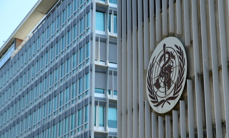 A logo is pictured on the headquarters of the WHO in Geneva