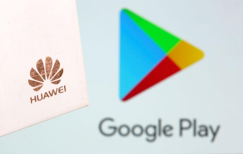 Huawei logo is seen in front of displayed Google Play logo in this illustration taken