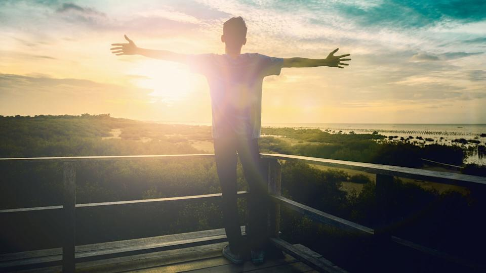 Silhouette freedom humble man rise hands up inspire good morning.