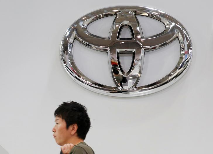 A man walks past a Toyota Motor Corp logo at the company's showroom in Tokyo