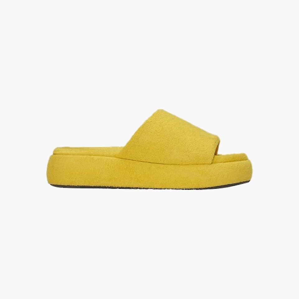 """$125, SIMON MILLER. <a href=""""https://www.simonmillerusa.com/collections/shoes/products/f166-terry-slide-yolk"""" rel=""""nofollow noopener"""" target=""""_blank"""" data-ylk=""""slk:Get it now!"""" class=""""link rapid-noclick-resp"""">Get it now!</a>"""