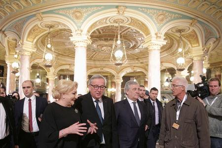 Romanian Prime Minister Viorica Dancila talks to European Commission President Jean-Claude Juncker and European Parliament President Anotnio Tajani as they arrive for the official ceremony marking the start of Romania's EU Council Persidency in Bucharest, Romania, January 10, 2019. Inquam Photos/Octav Ganea via REUTERS