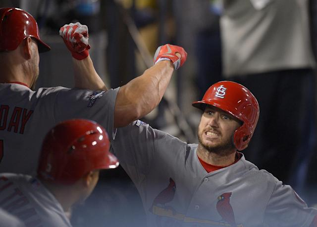St. Louis Cardinals' Shane Robinson celebrates his home run during the seventh inning of Game 4 of the National League baseball championship series against the Los Angeles Dodgers Tuesday, Oct. 15, 2013, in Los Angeles. (AP Photo/Mark J. Terrill)