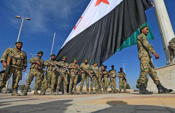 PHOTO: Turkey-backed Syrian fighters take part in a parade in the rebel-controlled town of Tal Abyad in Syria's northern Raqa province, on Oct. 13, 2020. (Bakr Alkasem/AFP via Getty Images)
