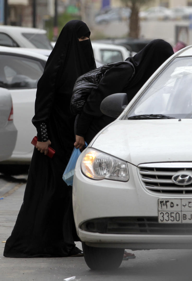 "Saudi women board a taxi in Riyadh, Saudi Arabia, Tuesday, May 24, 2011. A Saudi woman was arrested for a second time for driving her car in what women's activists said Monday was a move by the rulers of the ultraconservative kingdom to suppress an Internet campaign encouraging women to defy a ban on female driving. Manal al-Sherif and a group of other women started a Facebook page called ""Teach me how to drive so I can protect myself,"" urging authorities to lift the ban and posted a video clip last week of al-Sherif behind the wheel in the eastern city of Khobar. The page was removed after more than 12,000 people indicated their support for its call for women drivers to take to the streets in a mass drive on June 17. (AP Photo/Hassan Ammar)"