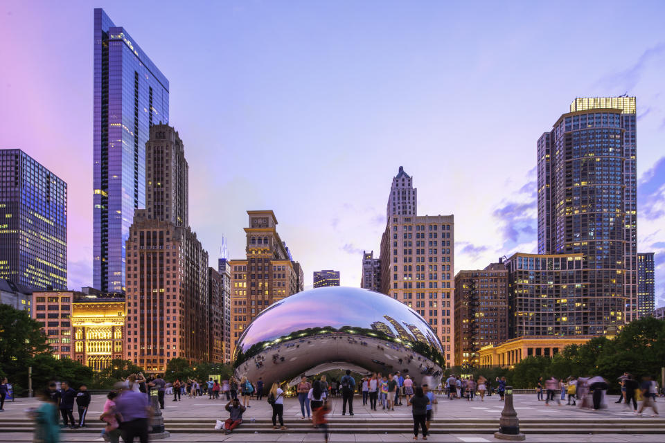 """August 16, 2019 - Chicago, USA - Cloud Gate also Called """"The Bean"""", in a summer night with tourists visiting the city"""