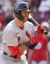 St. Louis Cardinals' Dylan Carlson is hit by a pitch during the eighth inning of a baseball game against the Cincinnati Reds in Cincinnati, Sunday, July 25, 2021. (AP Photo/Bryan Woolston)
