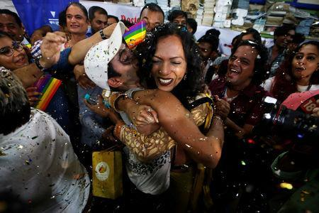 <p>Supporters of the lesbian, gay, bisexual and transgender (LGBT) community celebrate after the Supreme Court's verdict of decriminalizing gay sex and revocation of the archaic Section 377 law, at an NGO in Mumbai, India, September 6, 2018. REUTERS/Francis Mascarenhas </p>