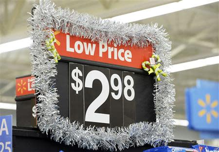 A discounted price is seen at the Wal-Mart Supercenter in the Porter Ranch section of Los Angeles in this November 26, 2013, file photo. REUTERS/Kevork Djansezian/Files